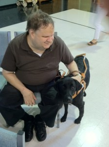 Retired Blind Baseball announcer Don Wardlow with his seeing eye dog Tori